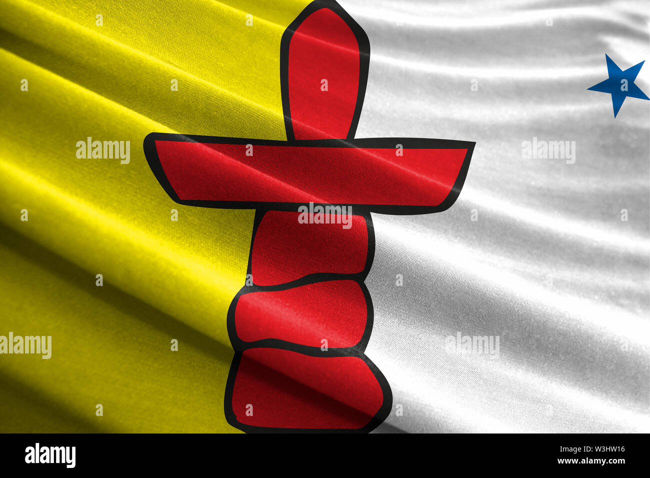 Realistic flag of Nunavut on the wavy surface of fabric - Stock Image