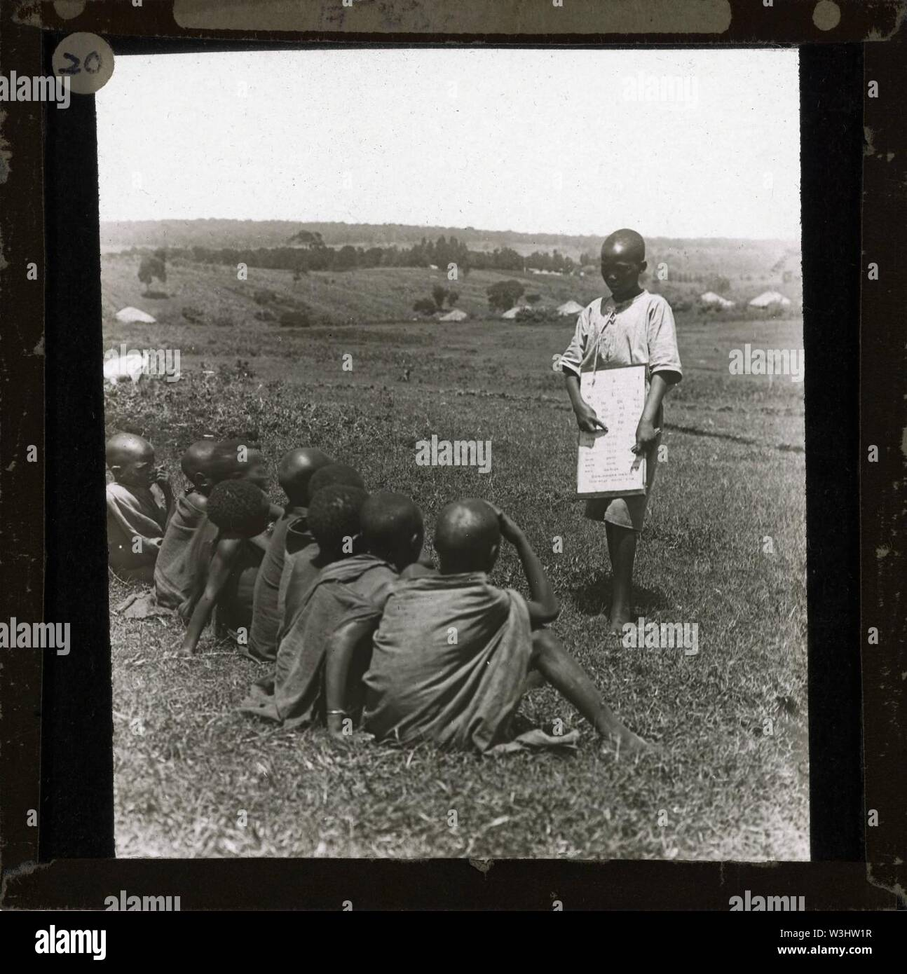 Class of Children Learning Outdoors, Kenya, ca.1905-ca.1940 (imp-cswc-GB-237-CSWC47-LS7-020). - Stock Image
