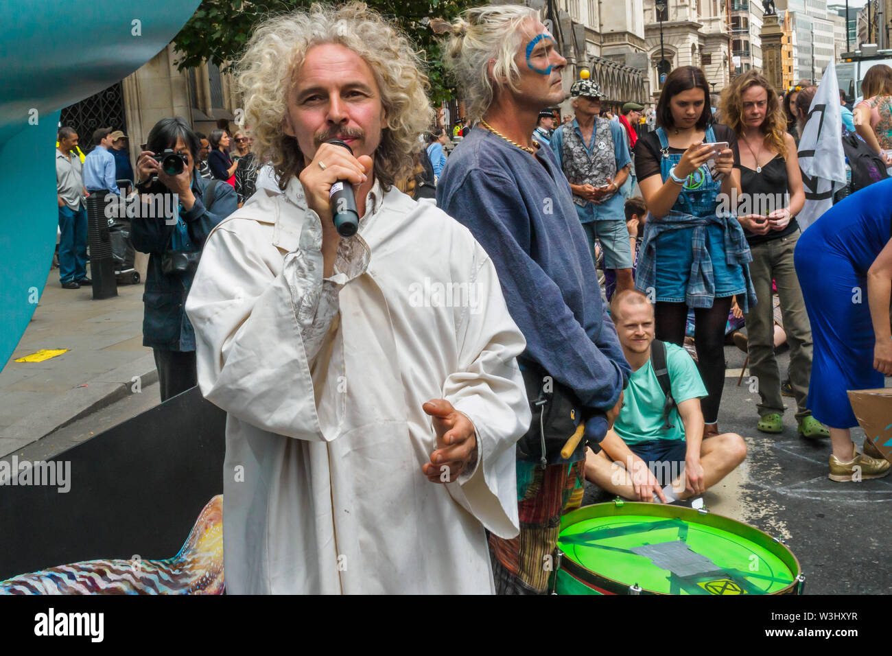 London, UK. 15th July, 2019. A druid presides in a ceremony against ecocide. Extinction Rebellion begins another series of protests in five major cities against the criminal inaction by the government on climate and ecological collapse. The protesters brought a yacht named after Polly Higgins who fought for years for an Ecocide Law to the Royal Courts of Justice and continued her fight blocking the Strand all day with performances, discussions, speeches, music and ceremonies in front of the yacht. Credit: Peter Marshall/Alamy Live News - Stock Image