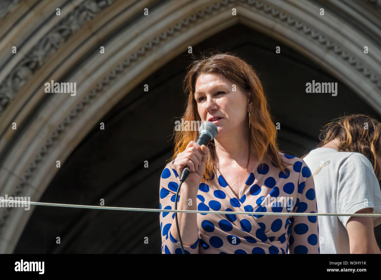 London, UK. 15th July 2019. Sue Hayman MP, Labour shadow minister for the environment, food and rural affairs  speaks from the yacht as Extinction Rebellion begins another series of protests in five major cities against the criminal inaction by the government on climate and ecological collapse. The protesters brought a yacht named after Polly Higgins who fought for years for an Ecocide Law to the Royal Courts of Justice and continued her fight blocking the Strand all day with performances, discussions, speeches, music and ceremonies in front of the yacht. Peter Marshall/Alamy Live News - Stock Image