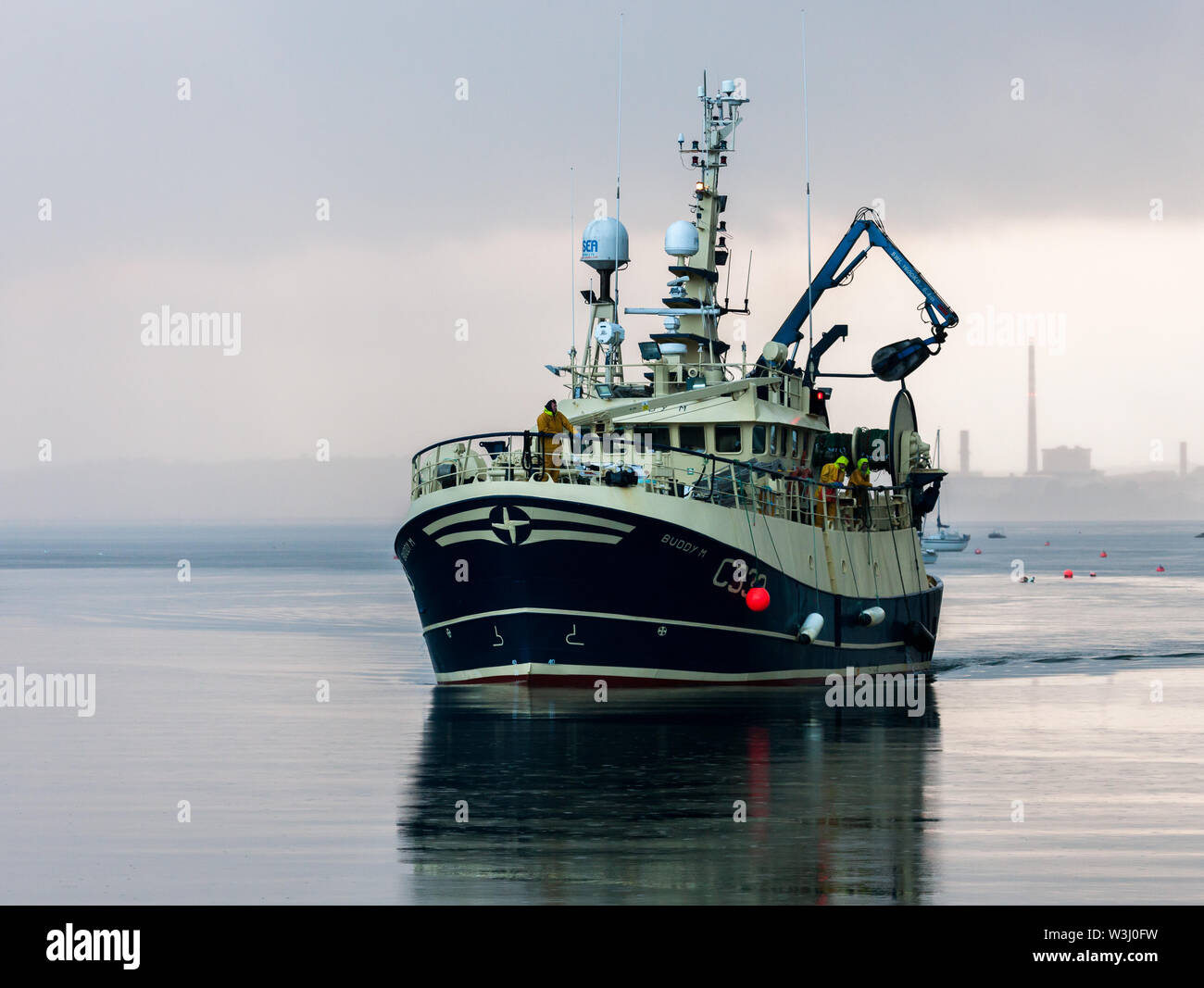 Crosshaven, Cork, Ireland. 16th July, 2019. Trawler Buddy M returns on an overcast morning from the Celtic Sea with a catch of Haddock and Whiting to Crosshaven, Co. Cork, Ireland. Credit: David Creedon/Alamy Live News - Stock Image