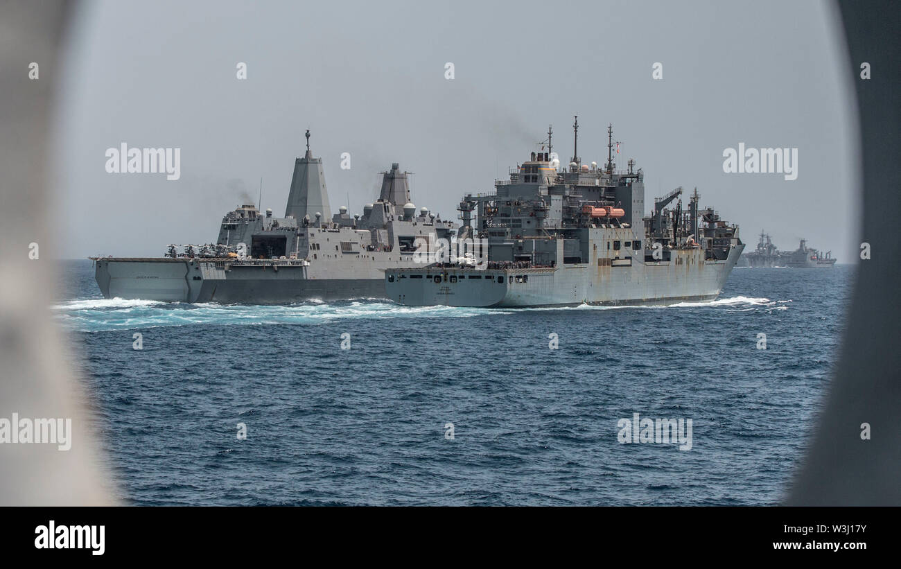 190630-M-QS181-1171 GULF OF ADEN (June 30, 2019) The San Antonio-class amphibious transport dock ship USS John P. Murtha (LPD 26) (left) receives fuel and supplies from the Lewis and Clark-class dry cargo ship USNS Cesar Chavez (T-AKE-14) during a replenishment-at-sea. The Boxer Amphibious Ready Group and the 11th MEU are deployed to the U.S. 5th Fleet area of operations in support of naval operations to ensure maritime stability and security in the Central Region, connecting the Mediterranean and the Pacific through the Western Indian Ocean and three strategic choke points. (U.S. Marine Corps - Stock Image
