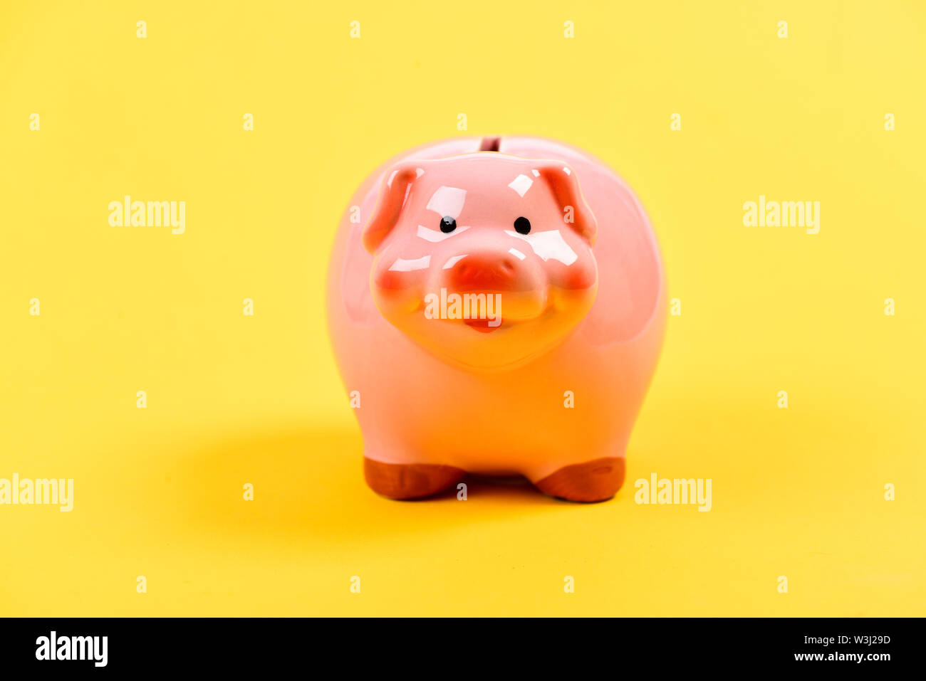 planning budget. financial problem. piggy bank on yellow background. income management. money saving. Financial education. Finances and investments bank. Financial crisis. new solutions. - Stock Image