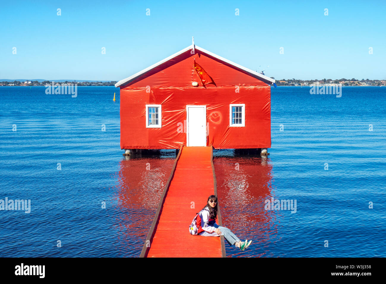 The iconic Crawley Edge Boatshed on the Swan River wrapped in red to commemorate the visit of Manchester United to Perth Western Australia. Stock Photo