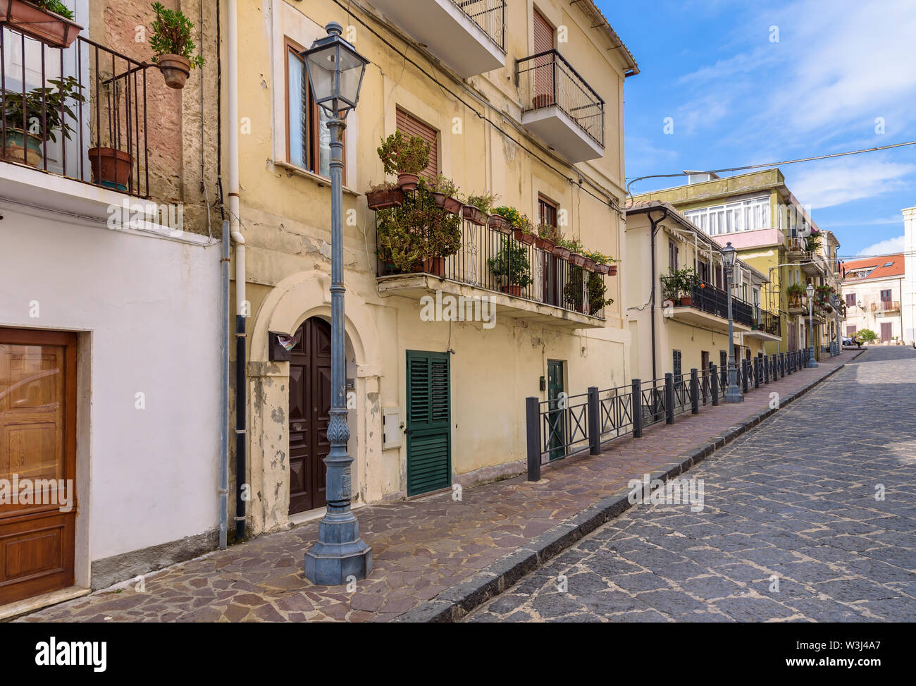 View of residential buildings at the picturesque alley in Pizzo town, Calabria, Italy Stock Photo
