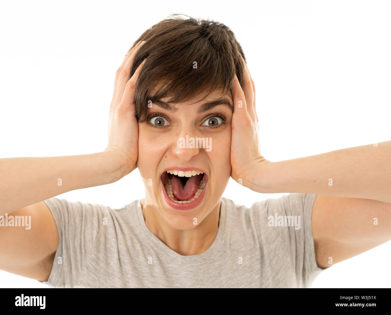 Portrait of beautiful shocked woman wining the lottery or having great success with surprised and happy Face and gestures in Facial Expression, Human - Stock Image