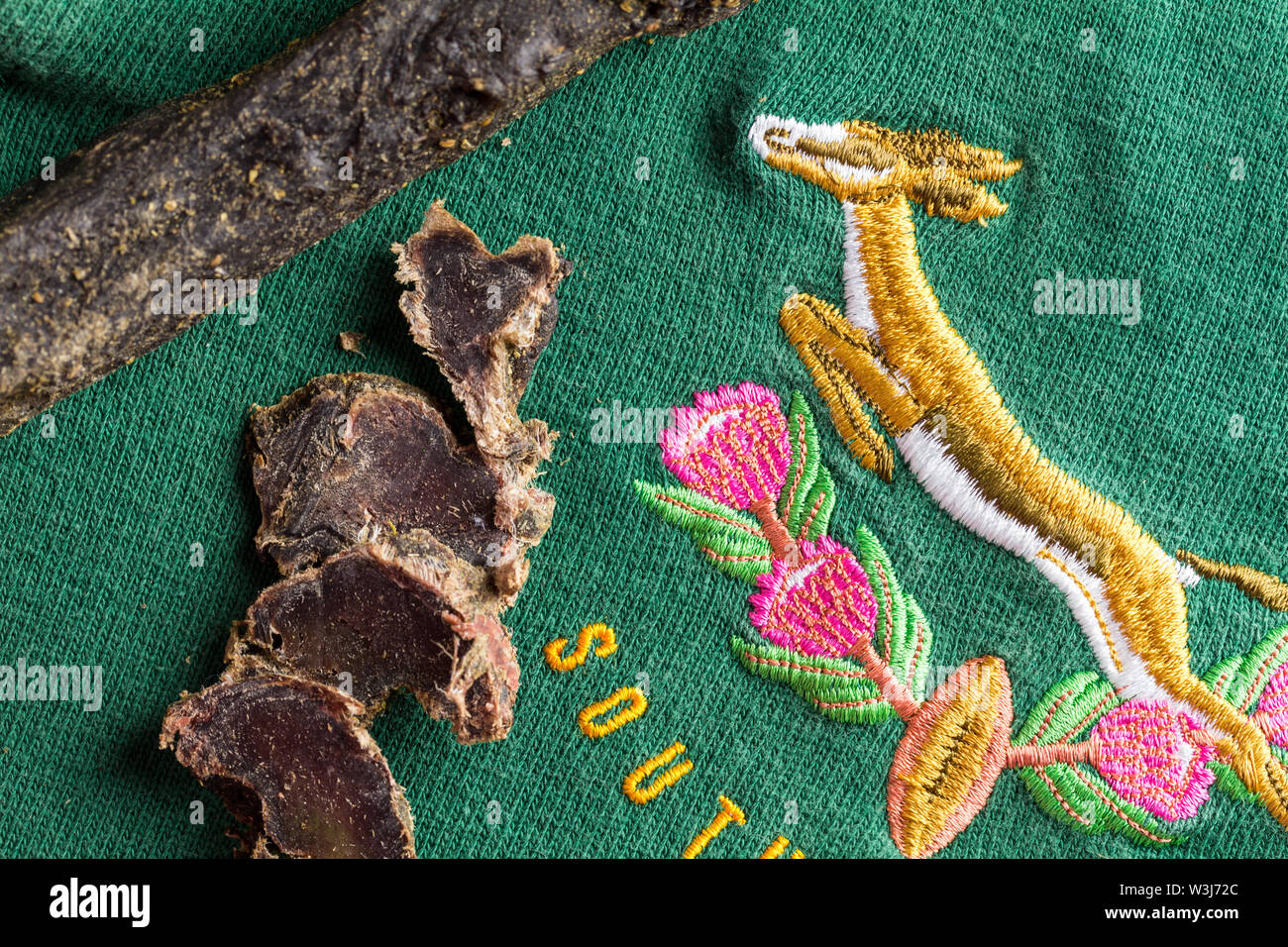QUEENSTOWN, SOUTH AFRICA - 16 JULY 2019 -South African Springbok rugby jersey circa 1995 World Cup with slices of venison biltong, typical South Afric - Stock Image