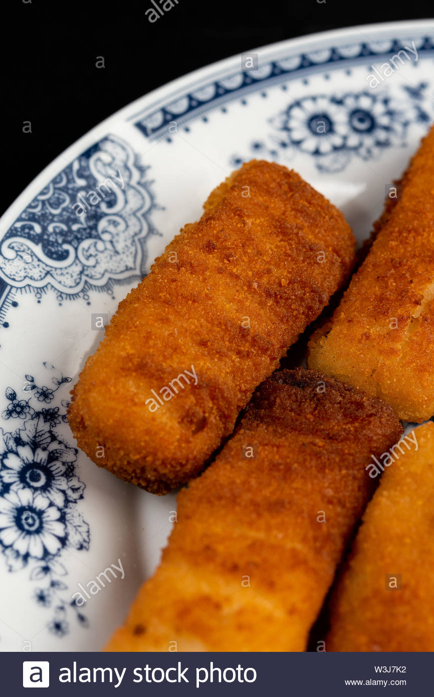 Fried Fish Sticks served on the plate. - Stock Image