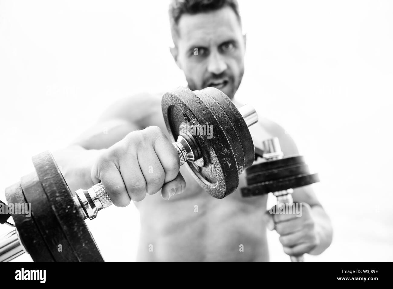 Muscular man exercising with barbell. fitness health diet. man sportsman with strong ab torso. steroids. athletic body. Dumbbell gym. sport equipment. Perfect six pack. Sport. i love sport. - Stock Image