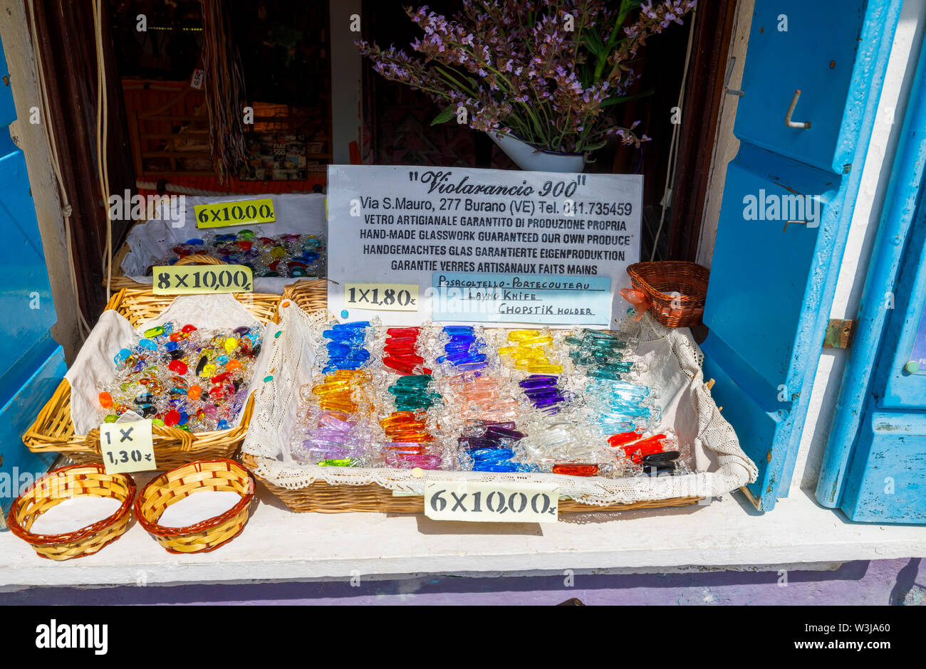 Display of gemstones and coloured glass for sale as tourist souvenirs in a typical roadside souvenir shop in Burano, a small island in Venice Lagoon - Stock Image