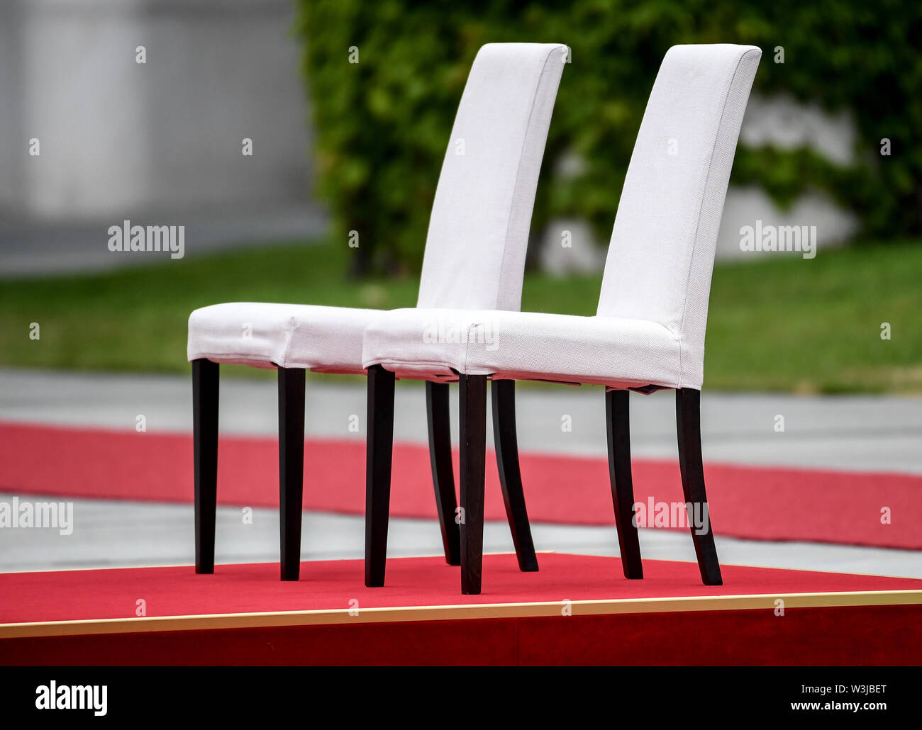 Berlin, Germany. 16th July, 2019. Chairs are available in the courtyard of honour of the Federal Chancellery, where Chancellor Merkel and the Prime Minister of Molda, Sandu, will watch the national anthems play. After several tremors during public appearances such as this, Merkel performed the ceremony for the first time last week, partly sitting down. Credit: Britta Pedersen/dpa-Zentralbild/dpa/Alamy Live News - Stock Image