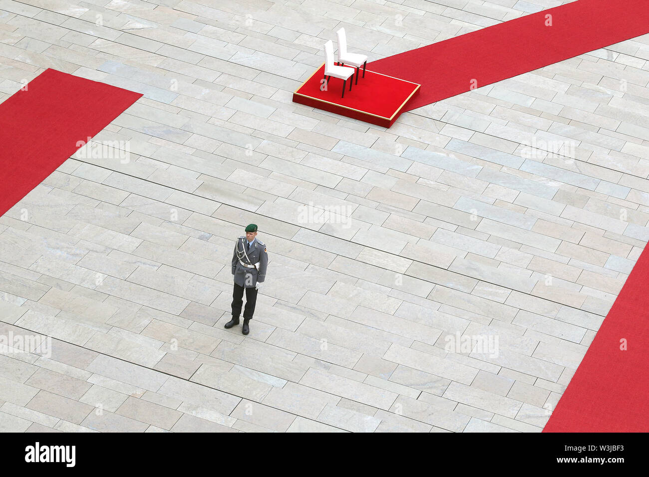 Berlin, Germany. 16th July, 2019. Chairs are available in the courtyard of honour of the Federal Chancellery, where Chancellor Merkel and the Prime Minister of Molda, Sandu, will watch the national anthems play. After several tremors during public appearances such as this, Merkel performed the ceremony for the first time last week, partly sitting down. Credit: Wolfgang Kumm/dpa/Alamy Live News - Stock Image