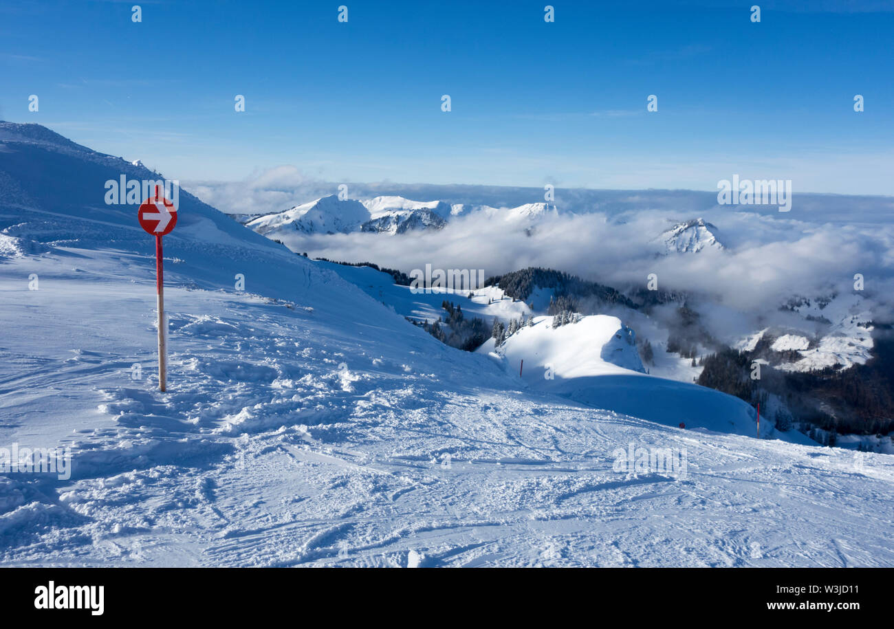 Red ski piste sign at a ski area - Stock Image
