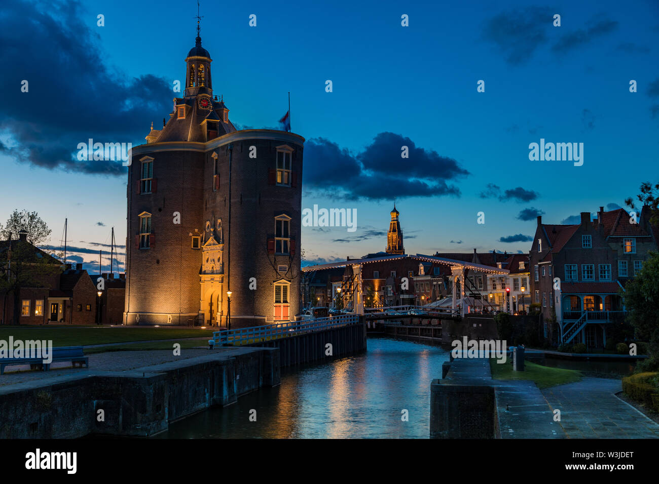 Historic Drommedaris Gate - city gate of Enkhuizen in the Netherlands, at blue hour - dusk - Stock Image