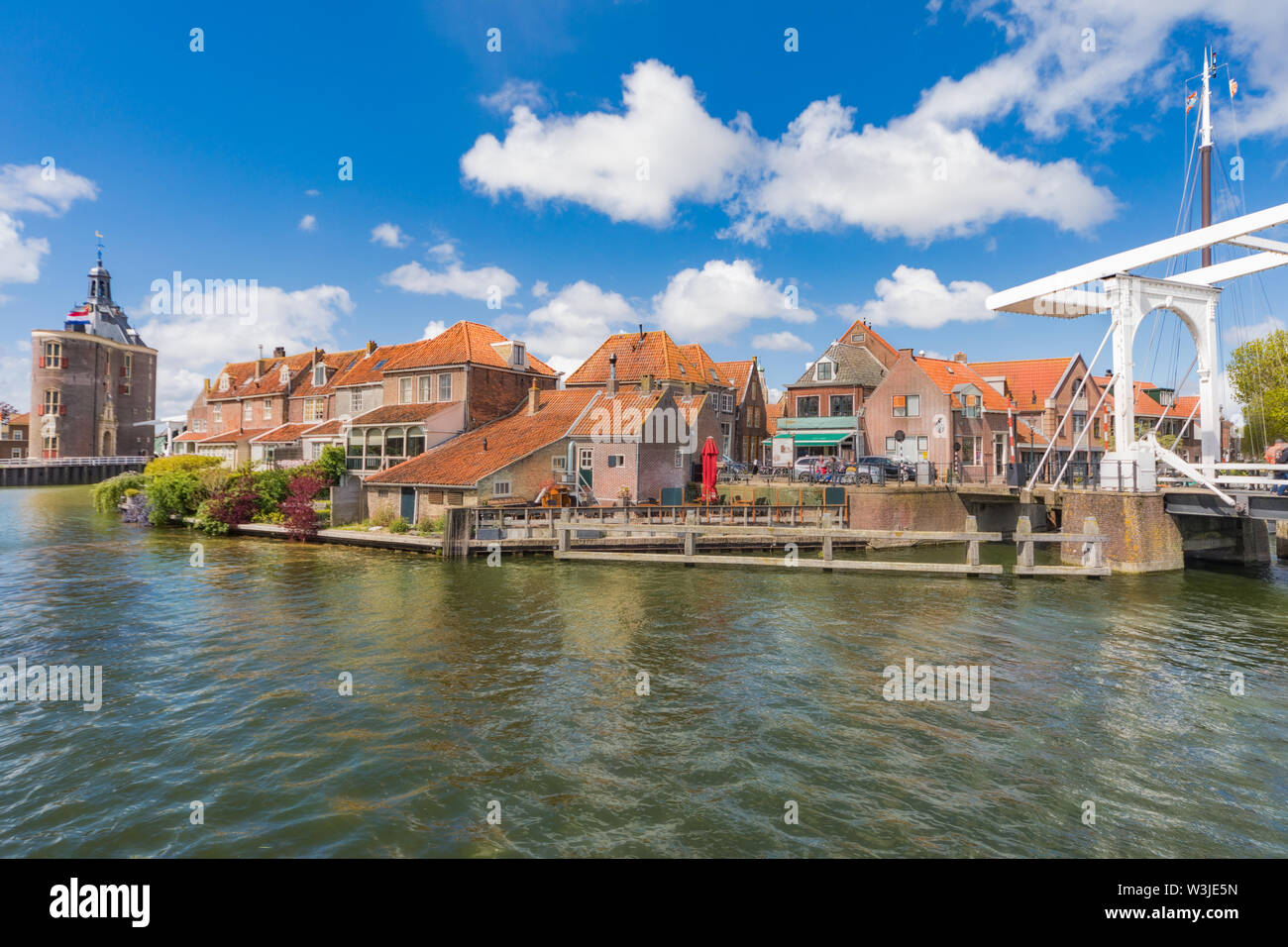 The center of Enkhuizen in the Netherlands with the old city gate - Drommedaris in the background. - Stock Image
