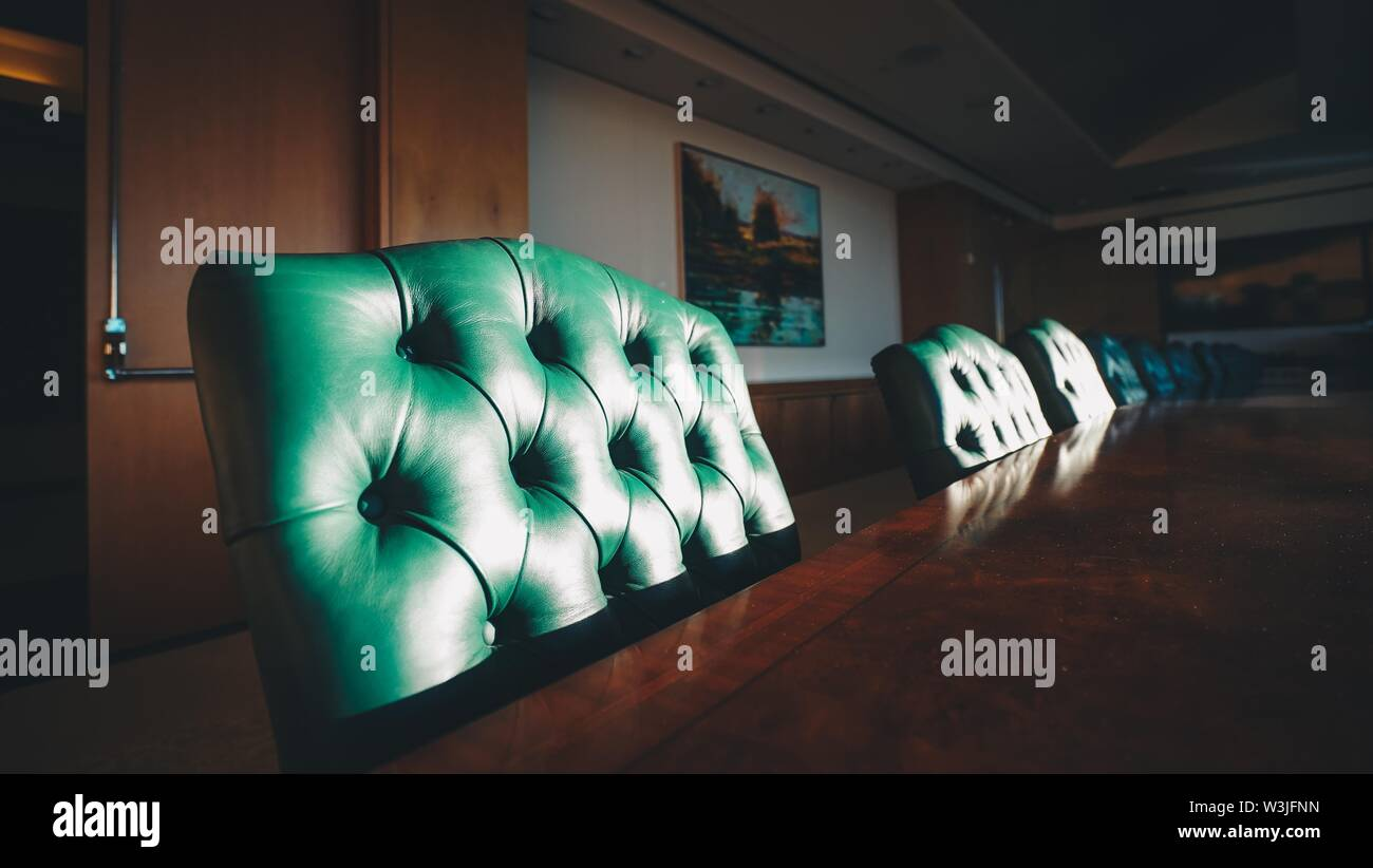 A closeup of chairs in an investment bank with pictures on the wall in San Francisco, CA. - Stock Image