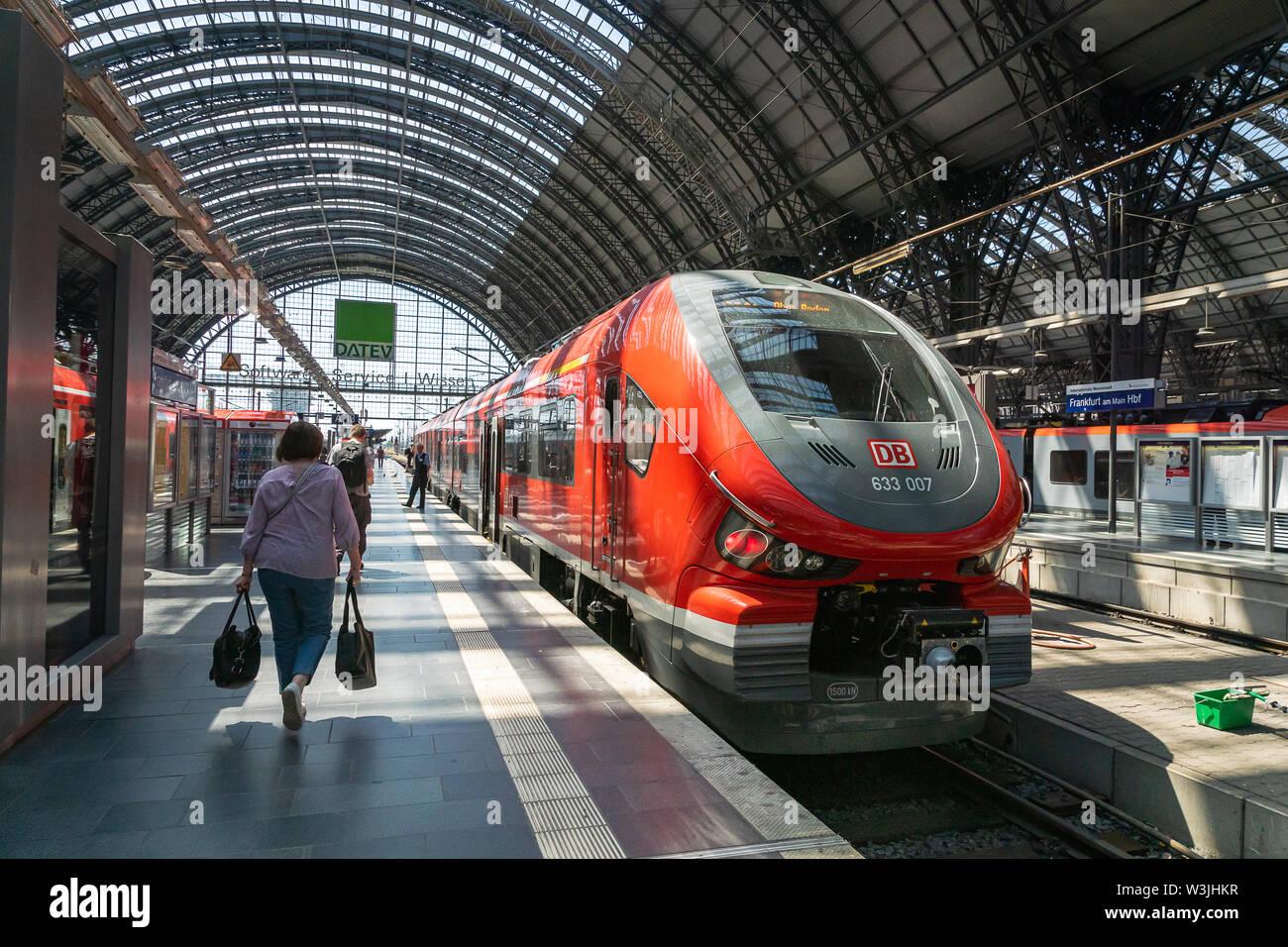 Frankfurt, Germany - July 2019: DB, Deutsch Bahn, trains and passengers at Frankfurt Main Train station platform. Stock Photo