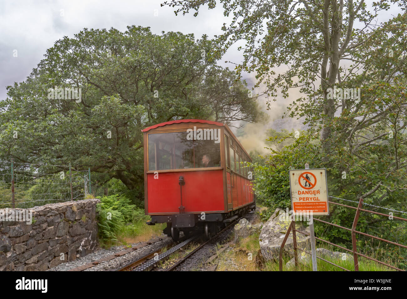 Mount Snowdon Railway, Llanberis, North Wales. A passenger carriage returning to Llanberis train station from the summit of Mount Snowdon - Stock Image