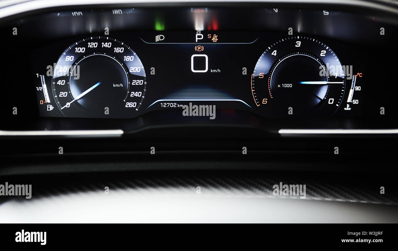 Car dashboard panel with speedometer, tachometer, odometer