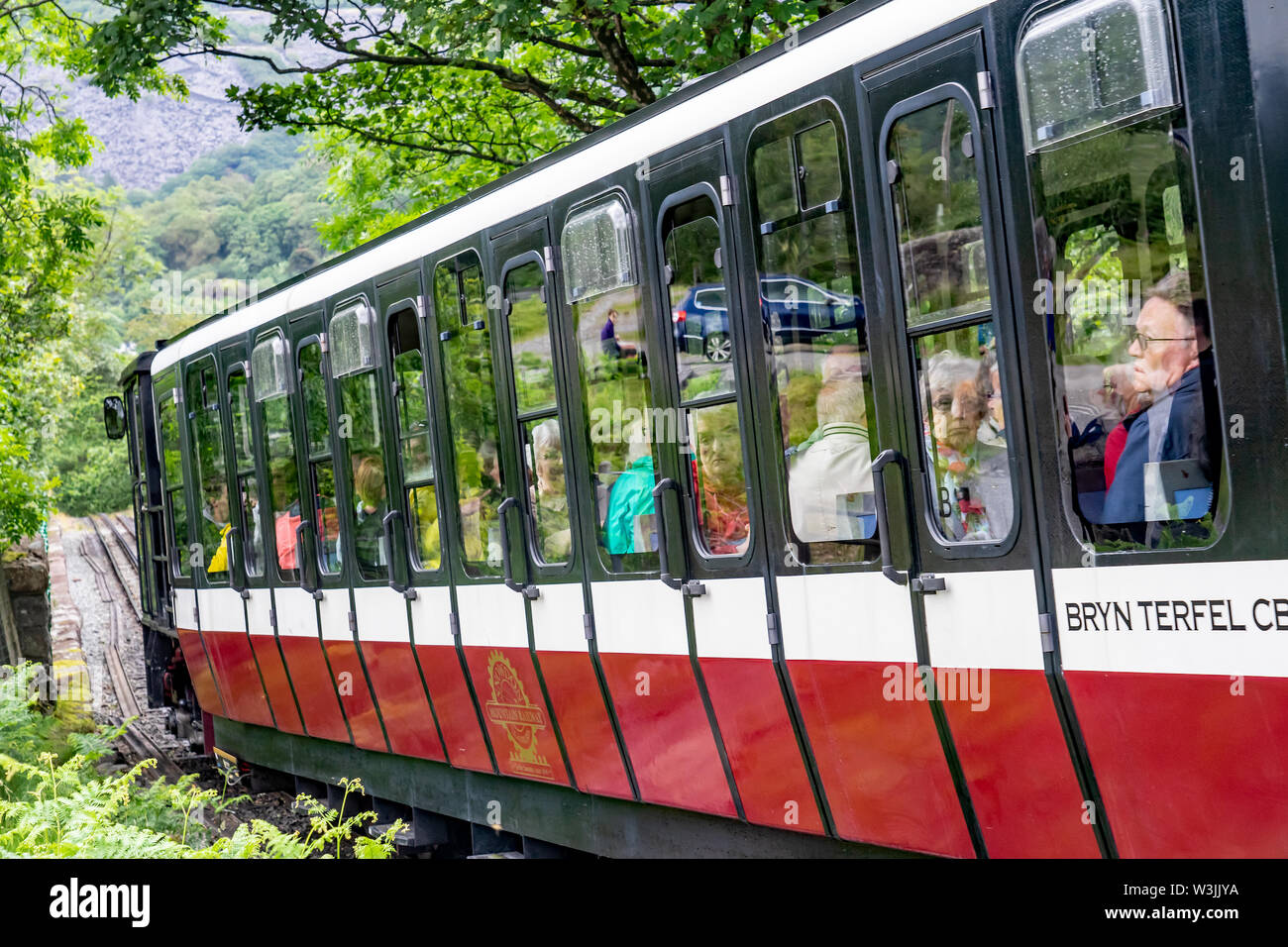 Mount Snowdon Railway, Llanberis, North Wales. A diesel train carrying passengers to the summit of Mount Snowdon - Stock Image