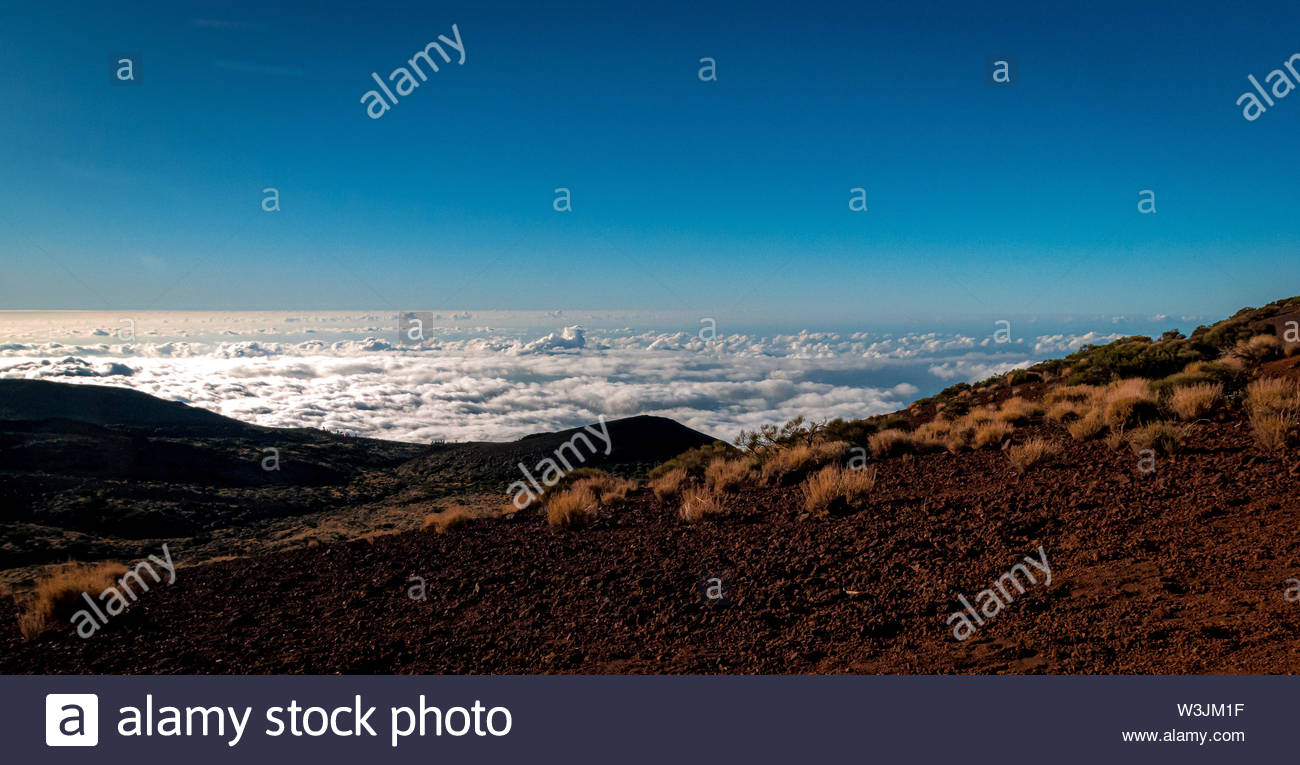 far view from the mountain over fascinating clouds - Stock Image
