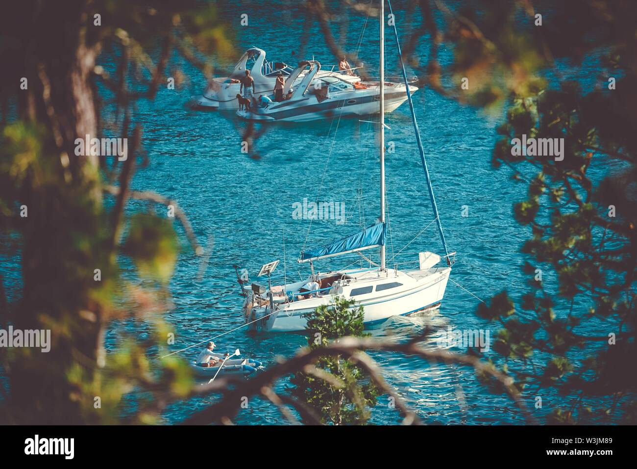 A two white yachts sailing on the water on East Shore of Lake Tahoe on a sunny day - Stock Image