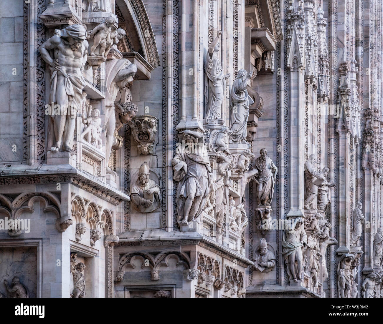 Facade of Duomo Cathedral with details, statues and marble works, Milan, Italy, Stock Photo