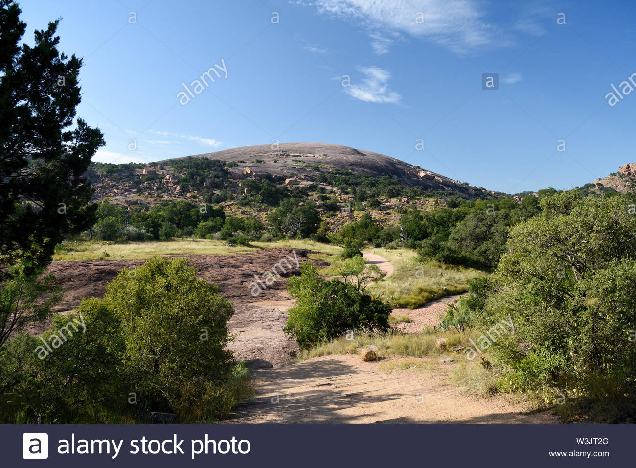 July in Texas. Summer Day at Enchanted Rock State Natural Area in the Texas Hill Country. Hot Summer Day in Texas. West of Austin in the Hill Country. - Stock Image