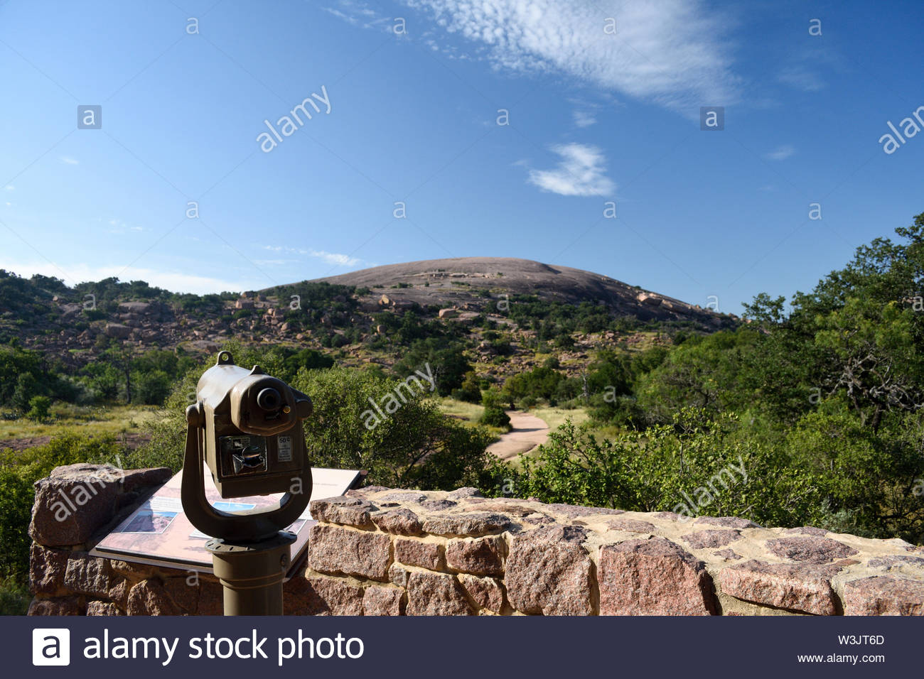 Enchanted Rock State Natural Area Gazebo Area. Enchanted Rock as viewed from the Gazebo. Interpretive signage, telescope, and rock wall. Trailhead - Stock Image