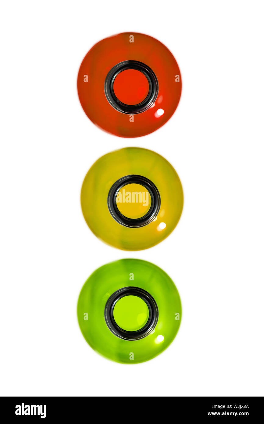 Drunk driving concept. Traffic offense. Drink alcohol behind the wheel. Traffic light from bottles, isolated. Red, yellow and green bottles. Stock Photo