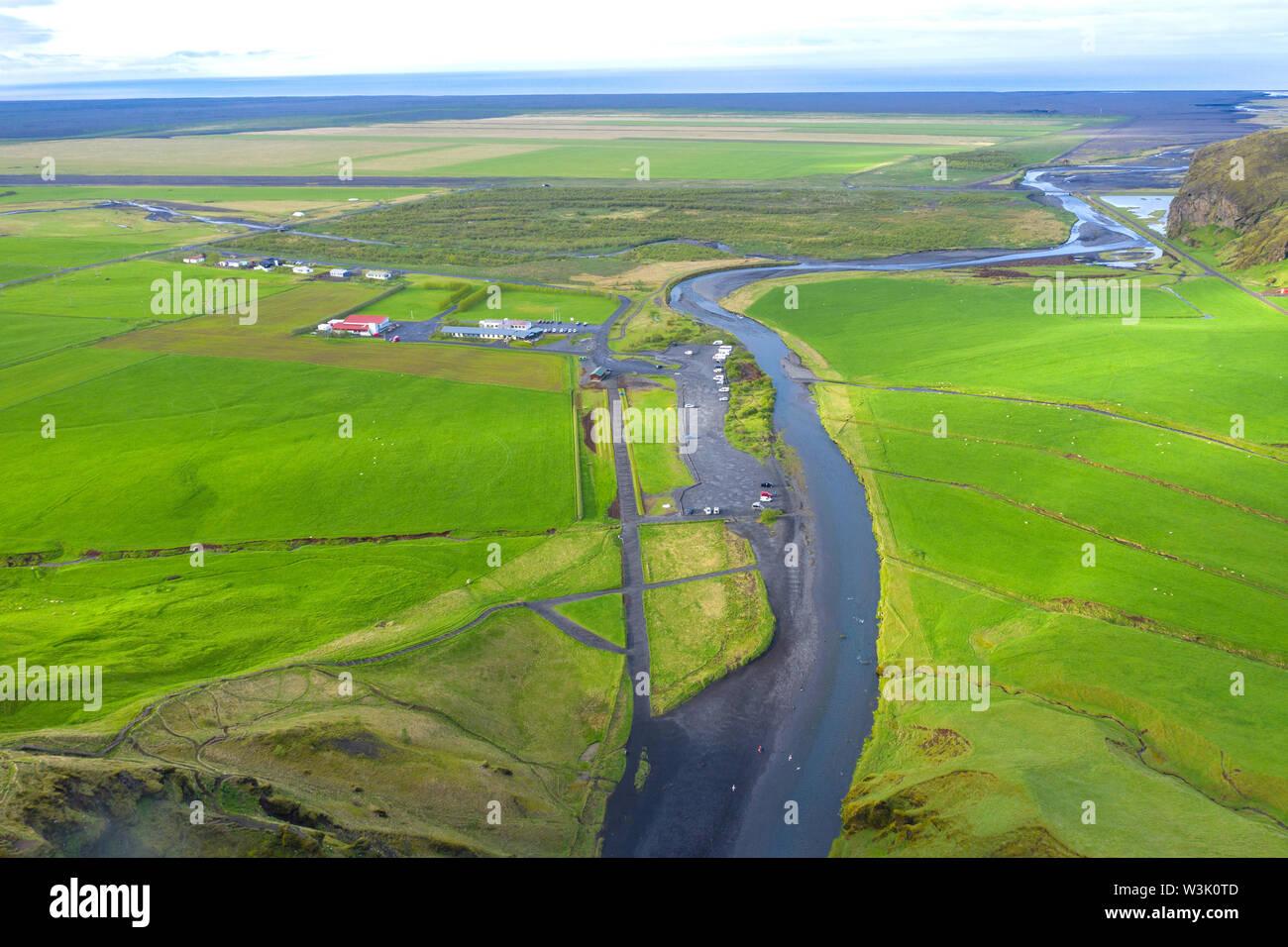 Skogar river, Iceland. Vibrant green Icelandic landscape - Stock Image