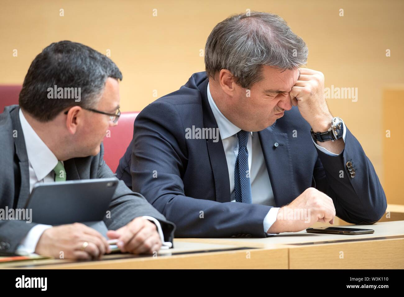 Munich, Germany. 16th July, 2019. Markus Söder (CSU, r), Prime Minister of Bavaria, and Florian Herrmann (CSU), Head of the State Chancellery and Minister of State for Federal Affairs, will take part in the plenary session of the Landtag. Topics include land consumption in Bavaria and a green draft for a Bavarian climate law. Credit: Sina Schuldt/dpa/Alamy Live News - Stock Image