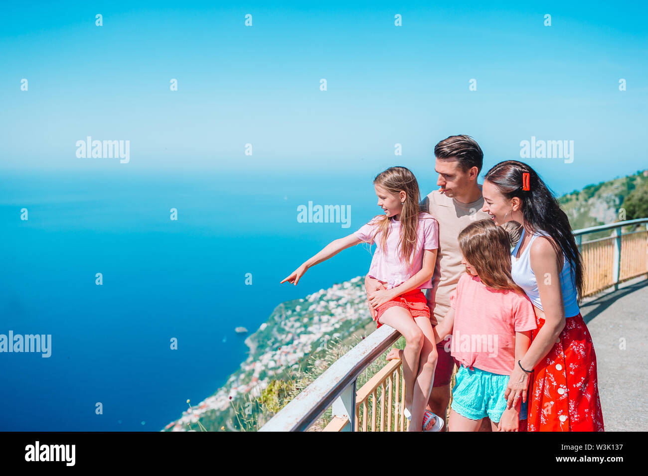 Summer holiday in Italy. Young family of four on the background, Amalfi Coast, Italy - Stock Image