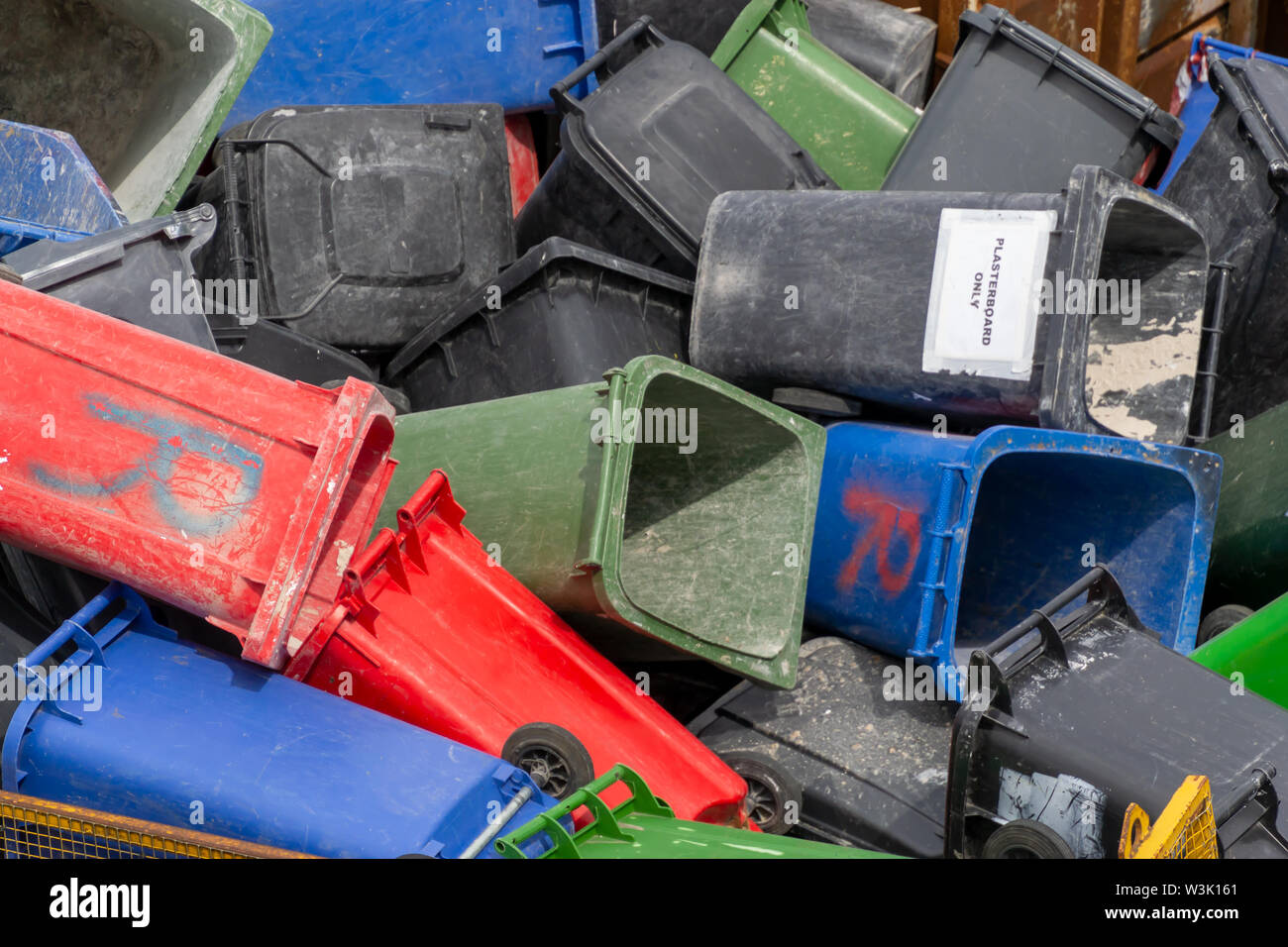 Colorful trash cans. Many plastic garbage cans on the waste waiting to be recycled. Produced from plastic that can be reused, recovery or disposal. - Stock Image
