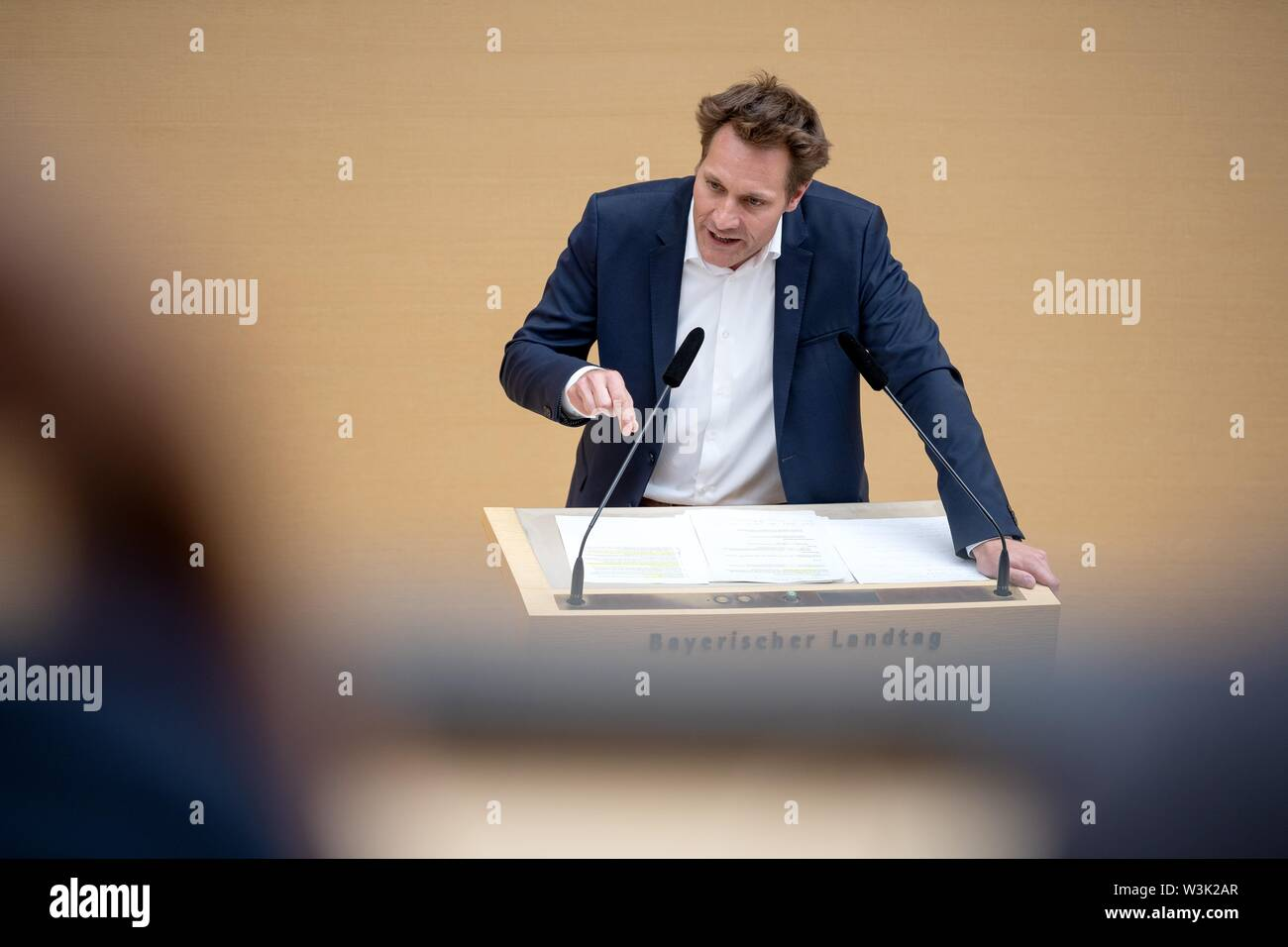 Munich, Germany. 16th July, 2019. Ludwig Hartmann (Bündnis 90/Die Grünen) speaks at a plenary session in the Landtag. Topics include land consumption in Bavaria and a green draft for a Bavarian climate law. Credit: Sina Schuldt/dpa/Alamy Live News - Stock Image