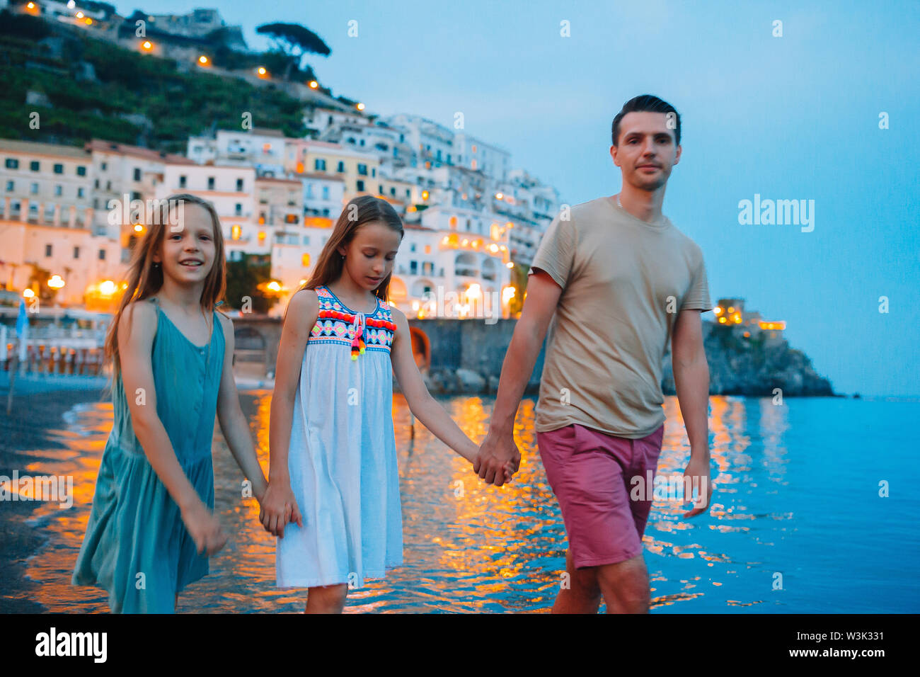 Adorable little girl on sunset in Amalfi town in Italy - Stock Image