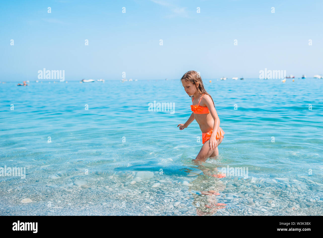 Cute little girl at beach during summer vacation - Stock Image