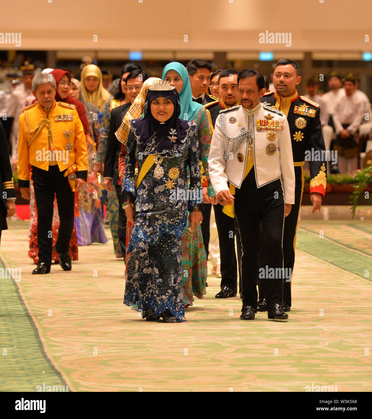(190716) -- BANDAR SERI BEGAWAN, July 16, 2019 (Xinhua) -- Brunei's Sultan Haji Hassanal Bolkiah (R, front) attends a state banquet in celebration of his 73rd birthday at Istana Nurul Iman, the royal palace, in Bandar Seri Begawan, capital of Brunei, July 15, 2019. Around 4,000 people comprising of members of the royal families, state dignitaries and foreign diplomatic corps, as well as foreign invited guests attended a grand state banquet in conjunction with the Sultan's 73rd birthday celebration on Monday night at the royal palace - Istana Nurul Iman. Born on July 15, 1946, the Sultan is - Stock Image
