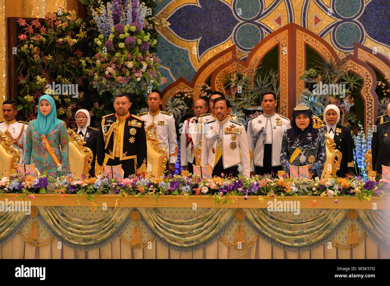 (190716) -- BANDAR SERI BEGAWAN, July 16, 2019 (Xinhua) -- Brunei's Sultan Haji Hassanal Bolkiah (2nd R, front) attends a state banquet in celebration of his 73rd birthday with other members of the royal family at Istana Nurul Iman, the royal palace, in Bandar Seri Begawan, capital of Brunei, July 15, 2019. Around 4,000 people comprising of members of the royal families, state dignitaries and foreign diplomatic corps, as well as foreign invited guests attended a grand state banquet in conjunction with the Sultan's 73rd birthday celebration on Monday night at the royal palace - Istana Nurul Ima - Stock Image