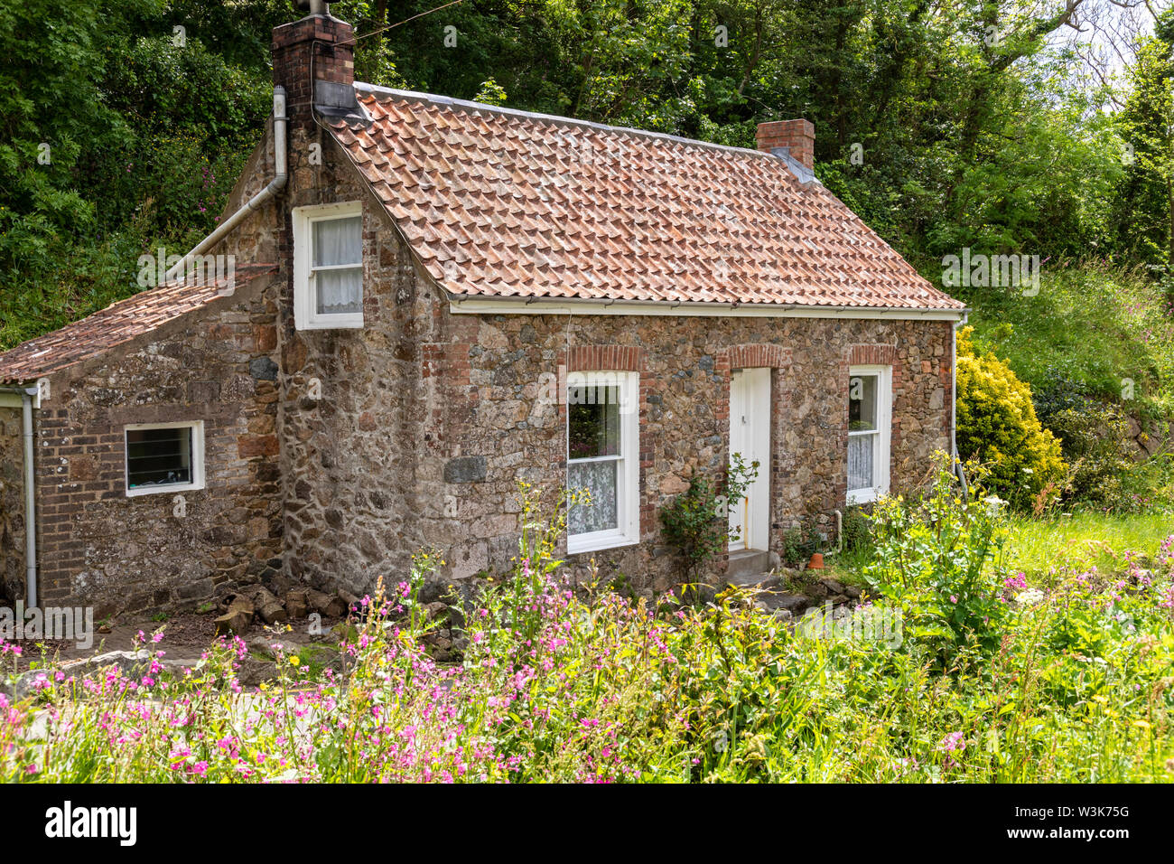 An old stone cottage at Petit Bot, Guernsey, UK - Stock Image