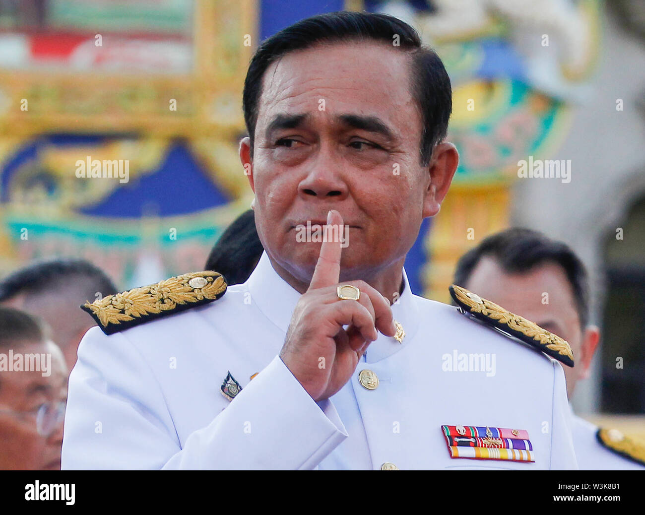 Thailand's Prime Minister, Prayuth Chan-ocha gestures after taking oath with his cabinet members in front of Thailand's King Maha Vajiralongkorn in Bangkok. - Stock Image