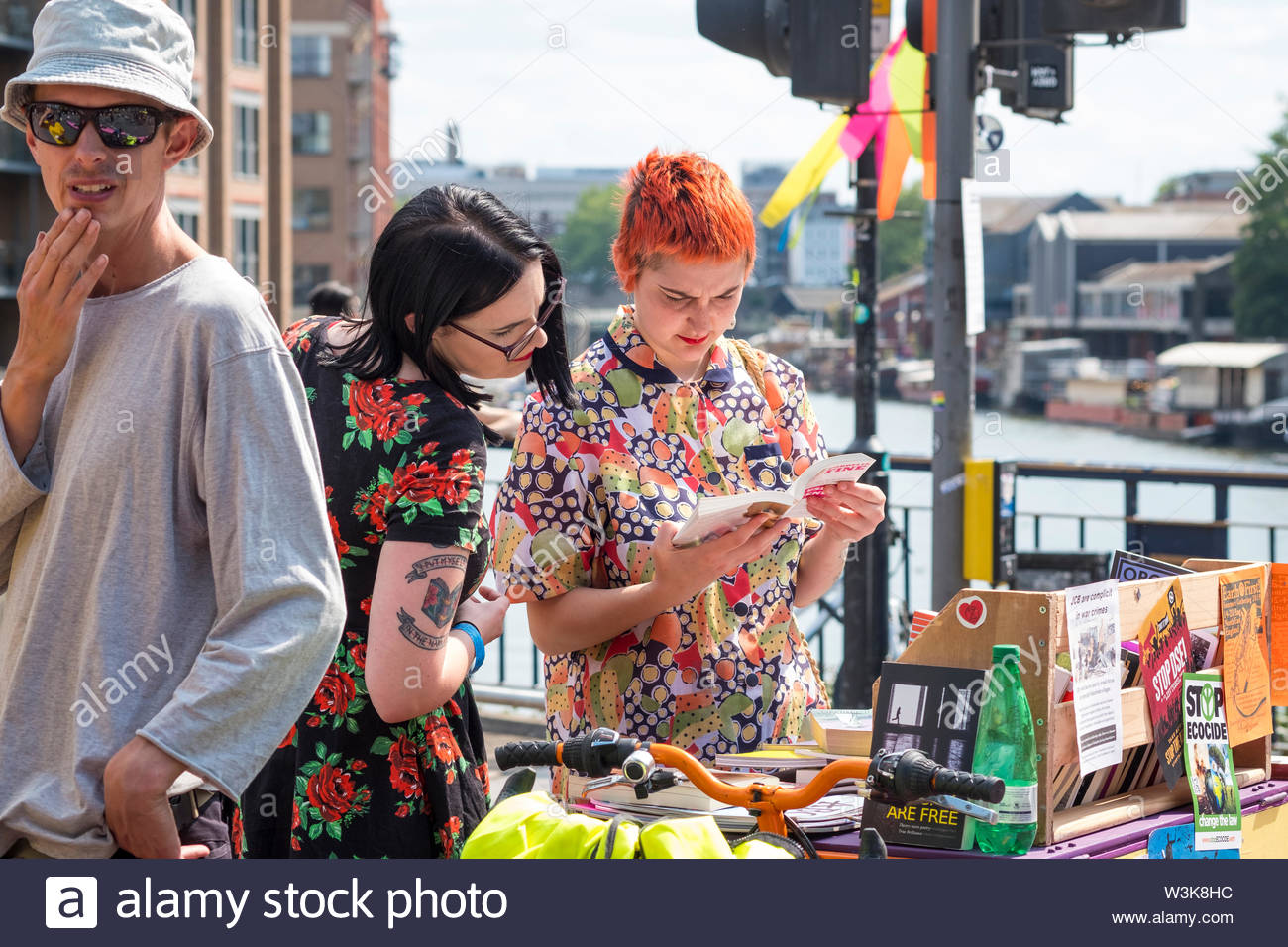 Bristol, United Kingdom - 16 July 2019: Extinction Rebellion supporters browse the improvised book store on Bristol Bridge as protesters take over Bristol city centre for a second day as part of their Summer Uprising campaign drawing attention to environmental issues. Credit: Andy Parker/Alamy Live News - Stock Image