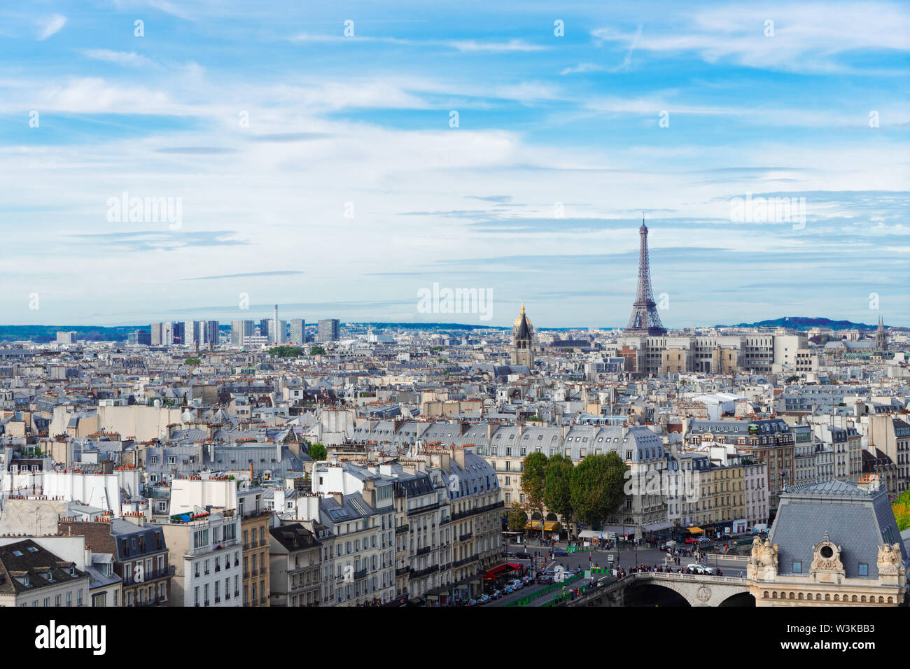 skyline of Paris city with eiffel tower from above in soft morning light with cloudscape, France - Stock Image