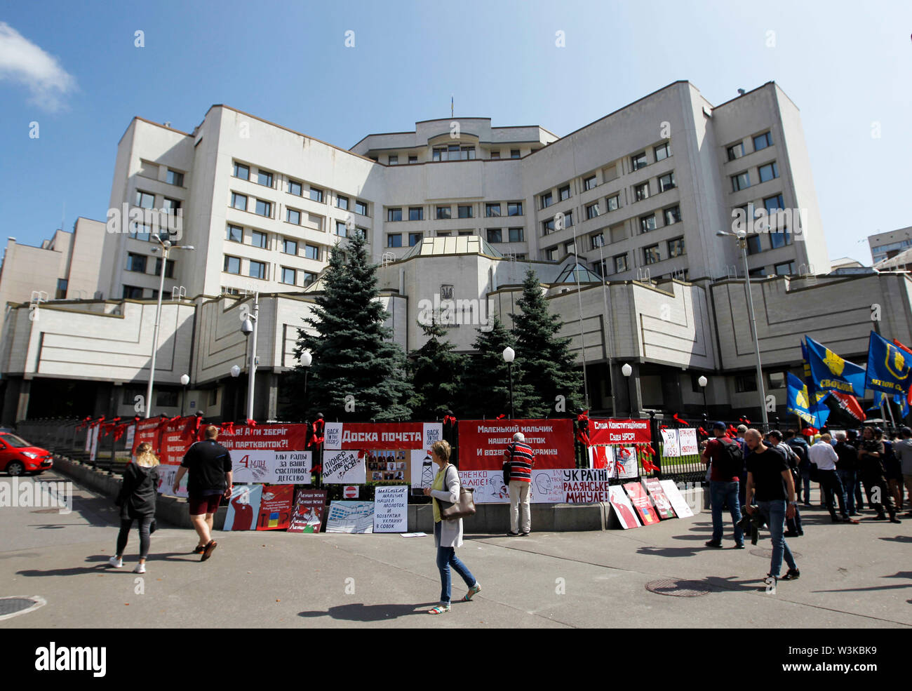 A view of placards depicting parody of Soviet era propaganda near the Ukrainian Constitutional Court building during a protest in Kiev.The activists protest against the cancellation of the laws on de-communization adopted by the Ukrainian Parliament on April 2015. 46 Ukrainian lawmakers, mostly supporters of former Russia-backed President Viktor Yanukovych, addressed the court to repeal the laws 'on the cleansing of power' and 'on condemnation of the communist and national socialist (Nazi) totalitarian regimes in Ukraine and the prohibition of their symbols. Stock Photo