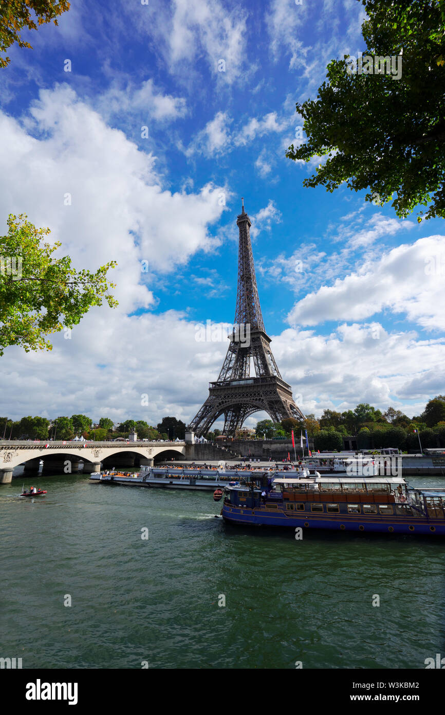 view of Eiffel Tower and Seine embankment, Paris France - Stock Image