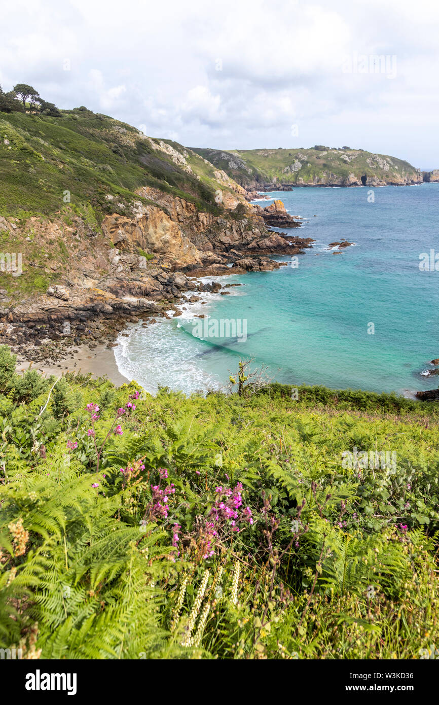 Looking down from the coastal path onto Petit Bot Bay on the beautiful rugged south coast of Guernsey, Channel Islands UK - Stock Image