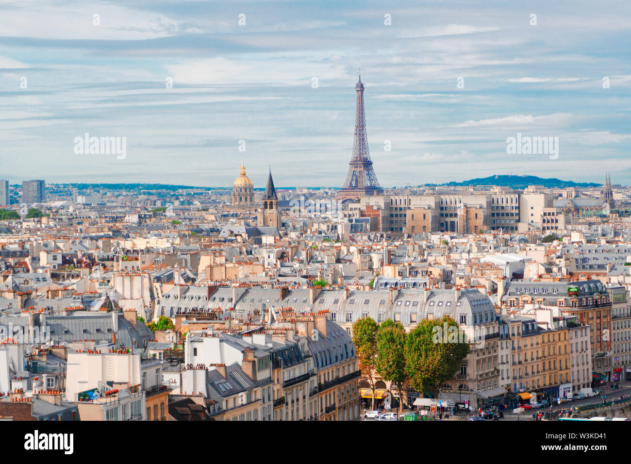 skyline of Paris city with famous eiffel tower from above in soft morning light with cloudscape, France - Stock Image
