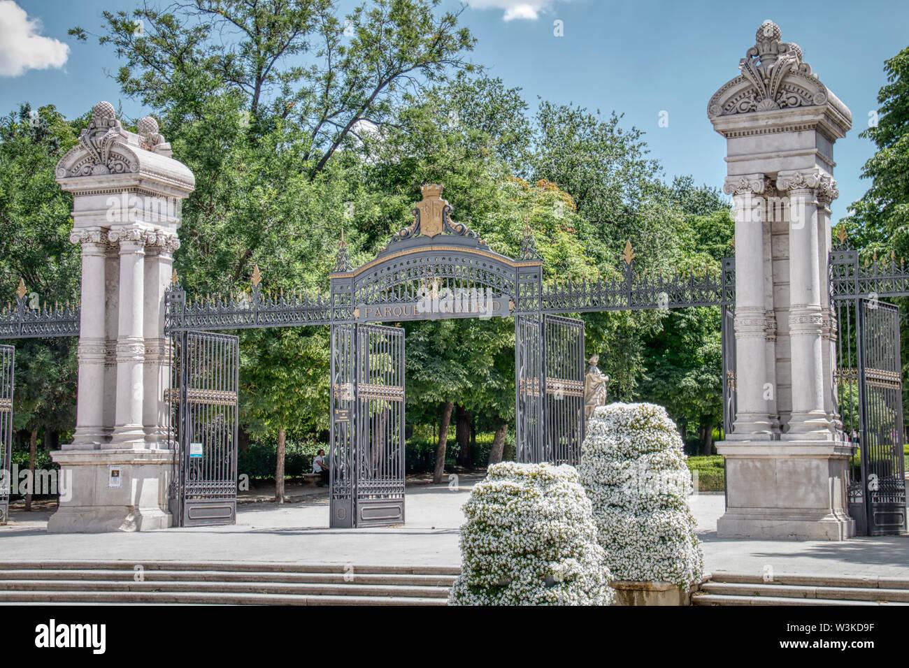 "Madrid, Spain - June 21, 2019: One of the entrances to the Buen Retiro Park (Spanish: Parque del Buen Retiro, literally ""Park of the Pleasant Retreat"" Stock Photo"