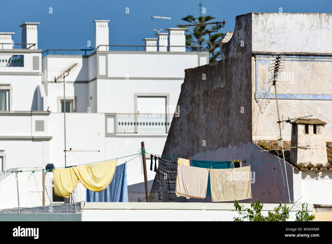 multiple cubic terrace whitewash on the traditional houses in Olhao, Algarve, Portugal - Stock Image