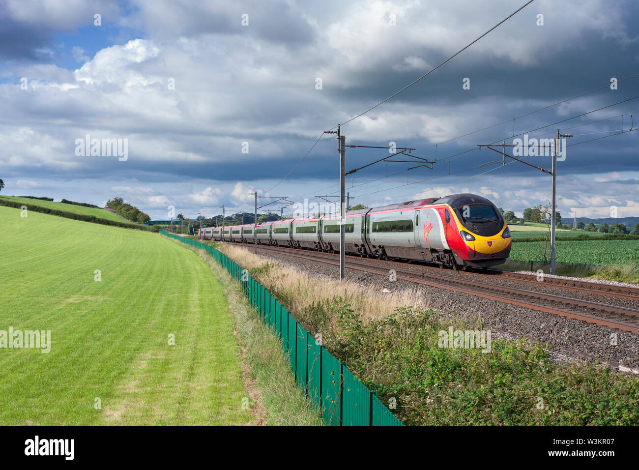 13/07/2019 Wellheads (south of Oxenholme) 390138 city of London 1640 Glasgow Central to London Euston - Stock Image